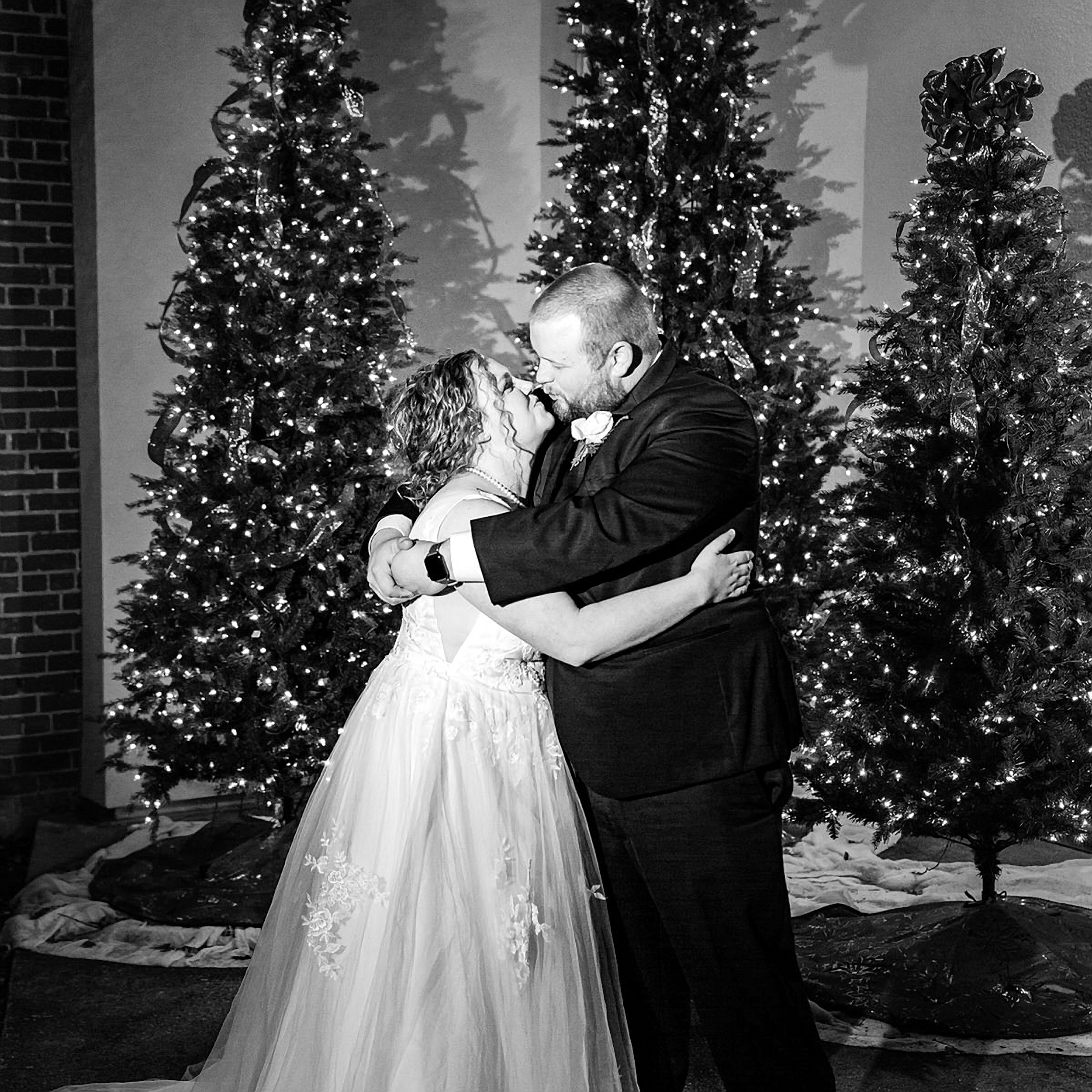 bride groom kiss Christmas trees black and white